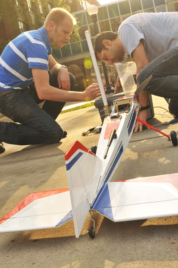 Phd Grad student Rohit Pandita, right, and U of M researcher Austin Murch, left, test the GPS system on an unmanned aerial vehicle (UAV).