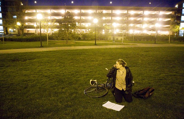 University senior Alice Vislova talks on her phone about rent payments on the lawn between Carlson School of Management and Wilson Library.