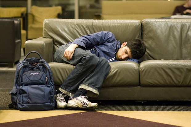 A student grabs some shut eye on a comfy couch in Coffman Memorial Union.