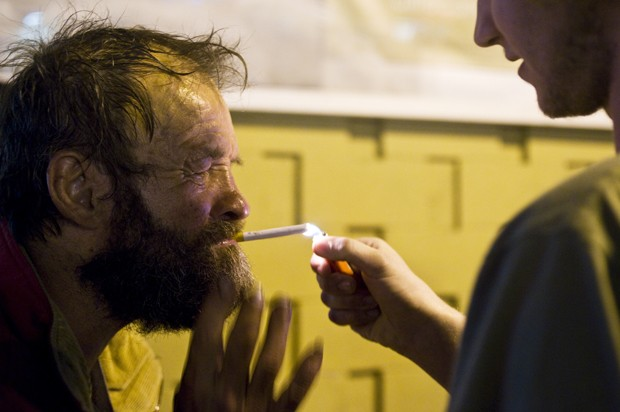Sam Torok lights Charlie's cigarette outside of Inkaholics Tattoo.
