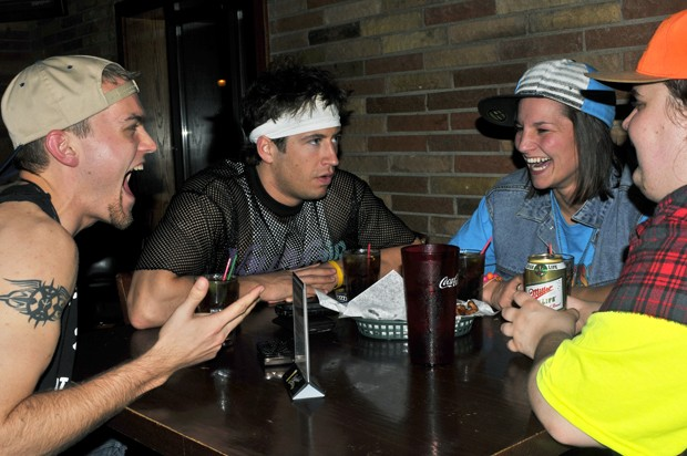A group of costumed patrons discuss Nascar at the Library Bar and Grills White Trash Wednesday in Dinkytown.