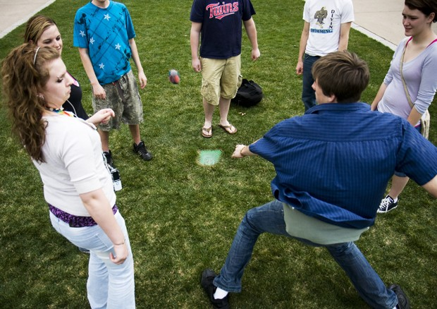 Students play hacky sack in the mall between Smith and Vincent Hall.