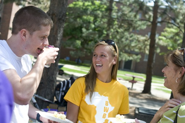 Former Biology Without Borders president Jenna Racine, middle, talks with Jan Swan, right, and Peter Swan at a picnic Thursday before departing to the airport.