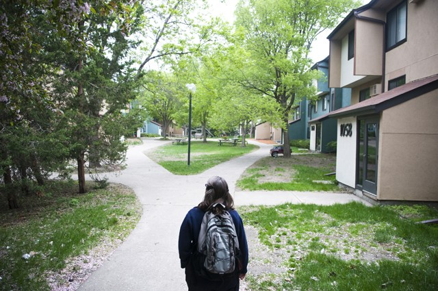 University environmental coordinator Janet Dalgleish walks through an area in the Como Student Community Cooperative on Monday which will be excavated starting next week. Several of the trees in that area will need to be removed.