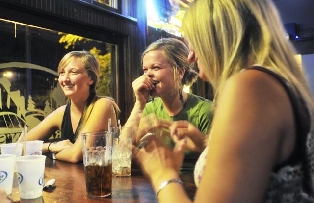 University seniors Sarah Arlt, left, Lauren Lammers, middle, and Amber Johnson enjoy free drinks during Ladie's Night at Preston's Urban Pub on Thursday.
