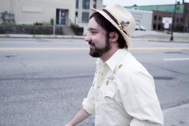 Poet and lyricist Chris Besinger Thursday outside Diamonds coffee shop.