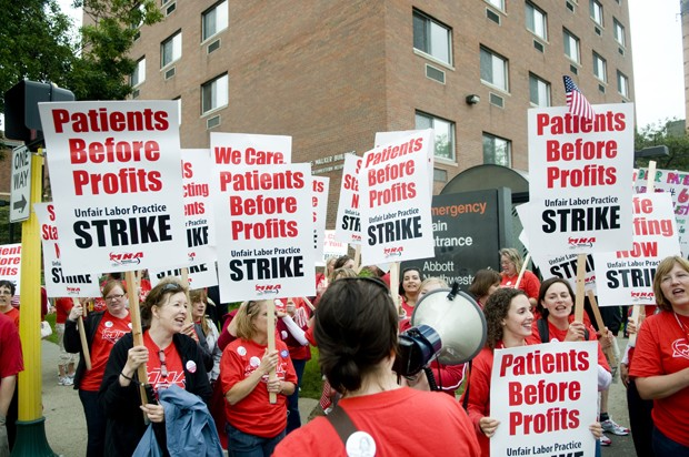 Nurses chant while on strike outside of Abbott Northwestern Hospital on Thursday, June 10.