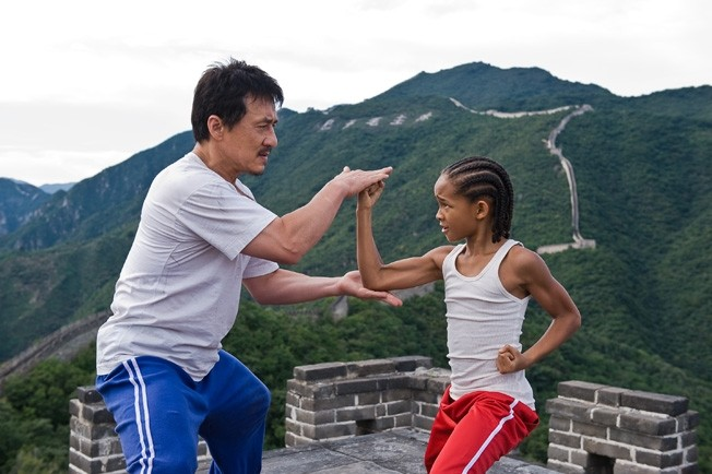 Mr. Han (Chan) teaching his young padawan (Smith)