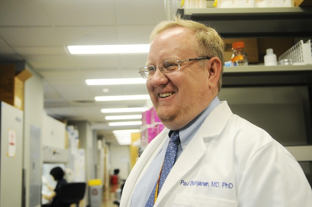 Dr. Paul Bohjanen, associate professor in the Microbiology Department at the University of Minnesota, explains the possible link between the increase in the HIV virus and immigration on Tuesday at the Mcguire Translational Research Facility.