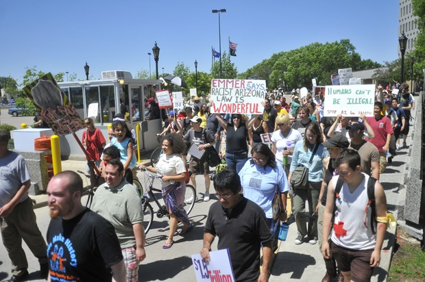 More than one hundred demonstrators protested the Arizona law S31070 as well as the Minnesota Historical Society's portrayal of