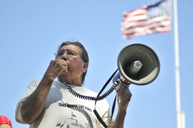 Dr. Chris Mato Nunpa speaks to a crowd of protesters about the history of Fort Snelling.