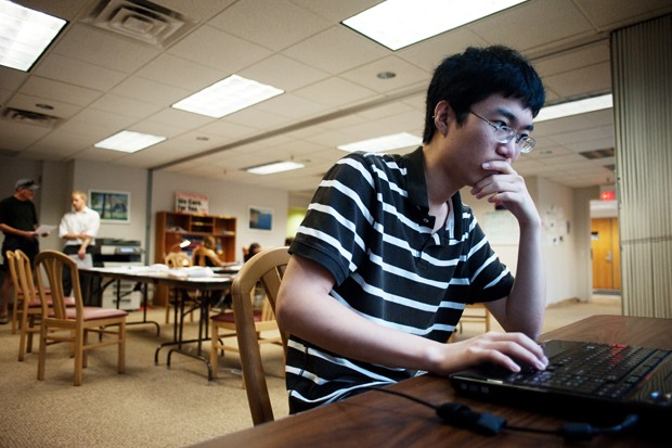 Sophomore Luis Wang researches for the Mark Dayton gubernatorial campaign on Monday in St. Paul. He is one of many student workers who participate in Minnesota politics.