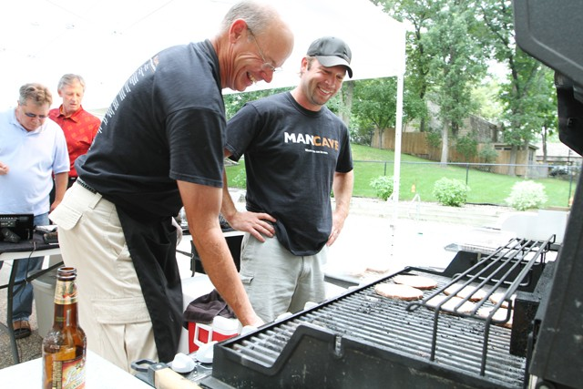 Jim Harvey, left, and national sales director Brad Rief, right, grill at a meating on Thursday in Eden Prairie.