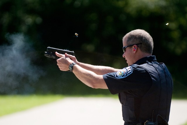"""LT. David Wilske shoots his pistol during the course of """"top gun"""" training day on Wednesday in Rosemount Minn. The volunteer set of drills is meant to hone officers  skills with weapons."""
