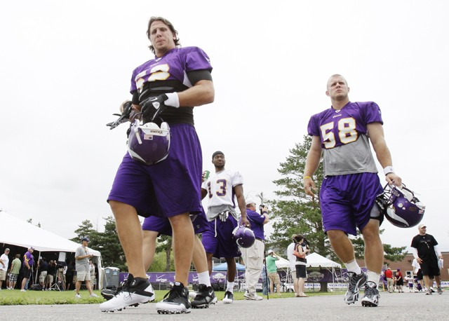 Minnesota Vikings linebackers Chad Greenway, left, and Nate Triplett, right, head to the field during the NFL team's training camp which opened Friday, July 30, 2010 in Mankato, Minn. (AP Photo/Jim Mone)