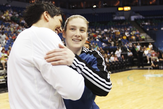 Janel McCarville, left, hugs ex-Gopher teammate Lindsay Whalen Sunday at the Target Center. The two led Minnesota to an improbable Final Four berth in 2004 as a No. 7 seed.