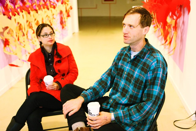 """Allen Brewer and wife Pamela Valfer discuss their """"Alternative Futures"""" exhibit on Friday morning at the Soo Visual Arts Center in Uptown. Their pieces explore the history in re-worked discarded material."""