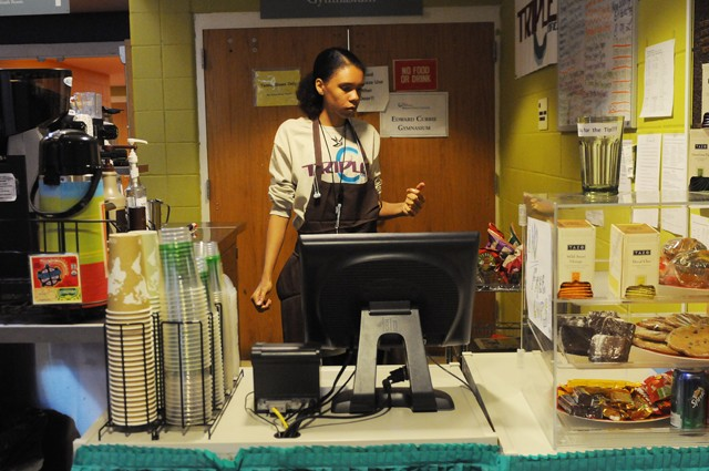 MTS High School senior Maylenna Acevedo works as a manager of the youth-run Triple C Café Friday at the Brian Coyle Community Center.  She was one of the six young people to complete an entrepreneurship course at the African Development Center and come up with the business plans for the café.