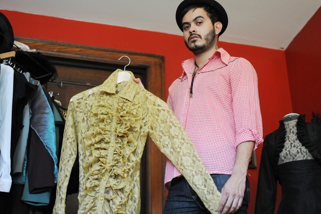 Local designer Raul Osorio displays one of his pieces Tuesday at his apartment studio in Uptown.
