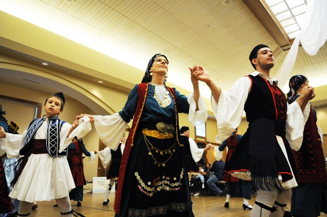 Local dancers Panos Delton, left, Vicki Withers, center and Nicholas Mortari perform at the Taste of Greece Festival Saturday at St. Mary's Orthodox Church in Uptown.  They are a part of the folk dance troupe Greek Dancers of Minnesota.
