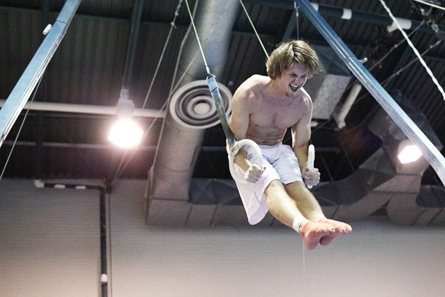 Gymnastic Club member and University of Minnesota junior Kevin Peterson practices on the still rings Wednesday.