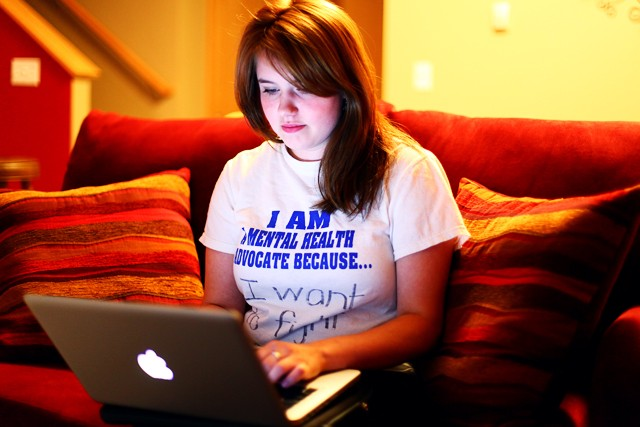 Junior Claire Chappuis representative for active minds, checks her e-mail Monday afternoon at her St. Paul apartment. Chappuis helps organizes events on campus.