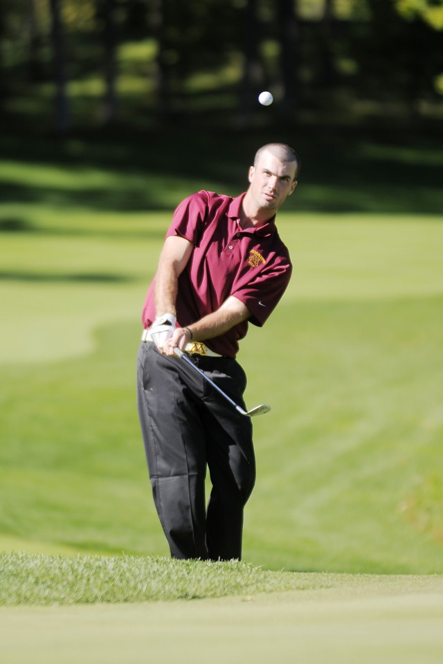 Senior Donald Constable chips Sunday during the first round of the Gopher Invitational Tournament in Wayzata.  Constable began the tournament with three straight birdies en route to a 36 hole total of 142