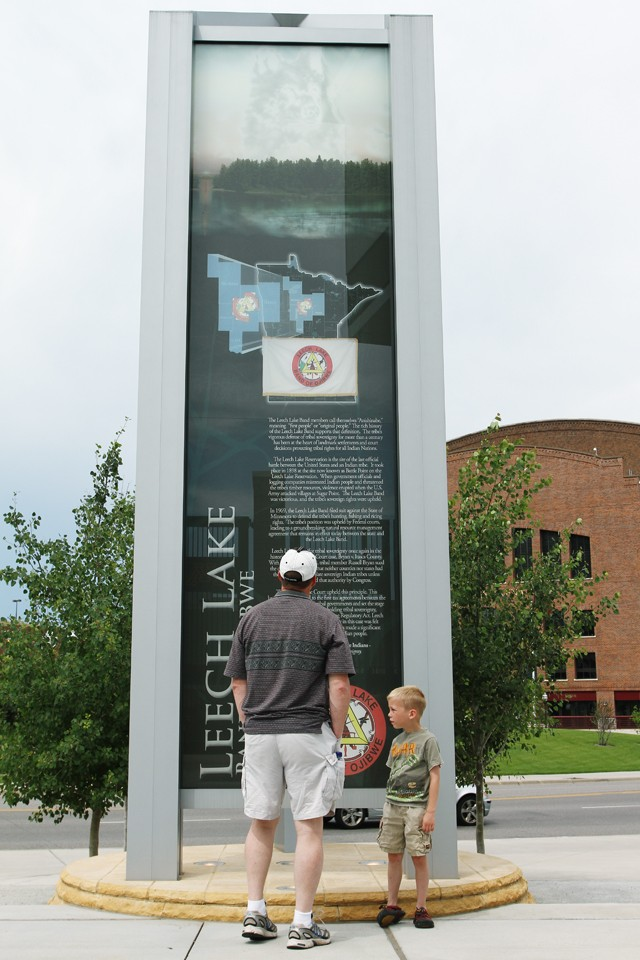 Jeff Martin of Thief River Falls, Wisc., reads the sky markers at the Tribal Nations Plaza at TCF Bank Stadium in July. The Shokapee Mdewakanton Sioux Community donated $10 million for the display, which commemorates tribes across the state.