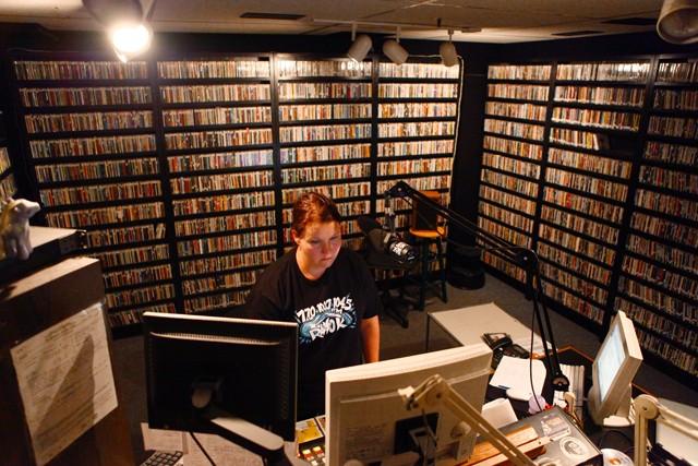 Radio K underwriting team member Jen Law fills in the DJ position Friday night at the studio.