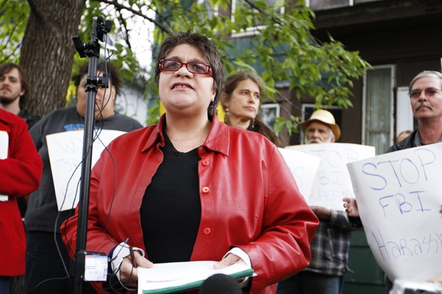 Jessica Sundin, a University clerical worker, speaks in front of her home, the site of an FBI raid, on Friday.