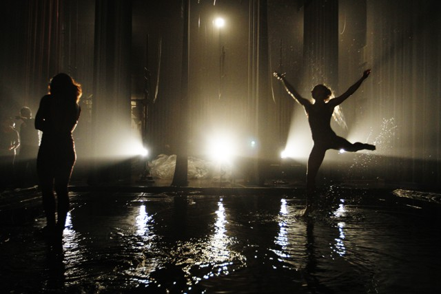 Dancers practice behind closed curtains as stagehands cover the stage with two tons of water during the second intermission of Tania Pérez-Salas' Waters of Forgetfulness Friday at Northrop Auditorium.