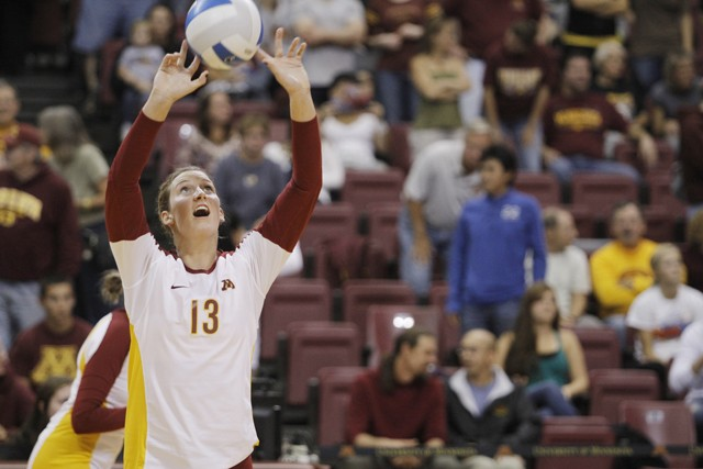 Gophers freshman outside hitter Ashley Wittman warms up before starting the second half of the game against Dayton Saturday at the Sports Pavilion.