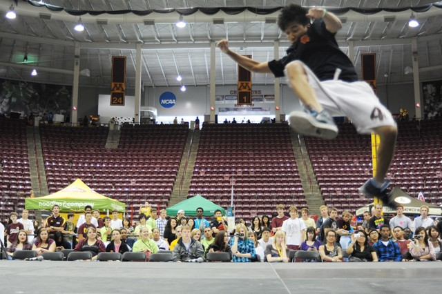 Hien Truong, a member of the Breakdancing student group, dances in front of freshman at Mariucci Arena during Welcome Week, Saturday. The Breakdancing group is one of many that performed on Welcome Week's Involvement and Engagement Day.