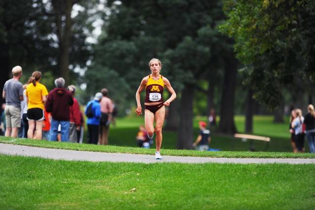 Junior Stephanie Price races in the Oz Memorial Run Friday in Falcon Heights. She went on to win the meet with a time of 21 minutes 16.5 seconds.
