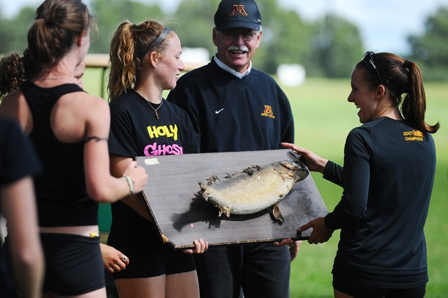 "Head coach Gary Wilson presents the second place team with ""Charlie the Fish"" on Saturday in Falcon Heights."