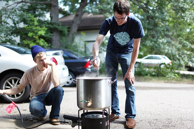 Jon Duesterhoeft, right, and Martin Menart, left, stand around their Bayou Classic in St. Paul Sunday.