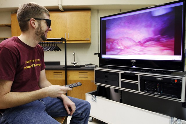 Graduate student and Medical Devices Center lab supervisor Lucas Harder watches a recording on a 3D surgical observation television Monday in Shepherd Laboratories.  The TV receives live 3D video via fiber optics from surgeries being preformed across the university.