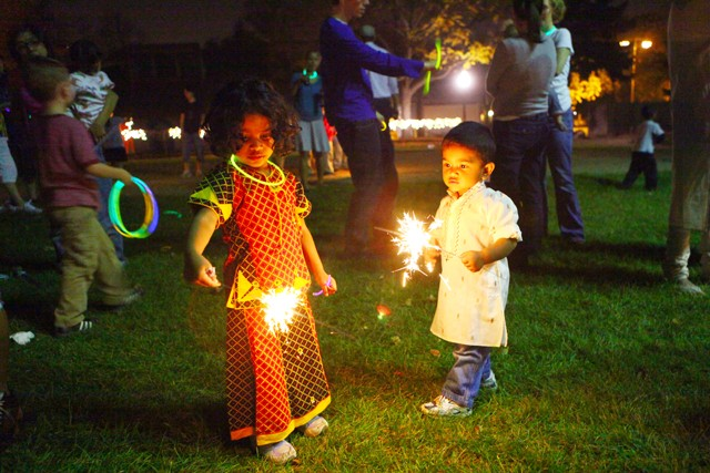 Children from the Como Student Community Co-op light sparklers Friday night after the Indian themed party thrown by the residents. The party celebrated cultural diversity in the community.