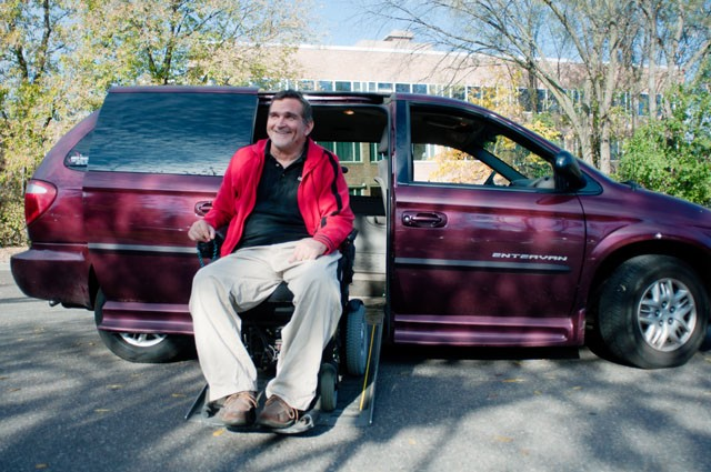 Jim Kelly demonstrates one of the handicapped accessible vans Monday at the Courage Center in Golden Valley. Vans similar to this will be used to pick up voters November 2nd.