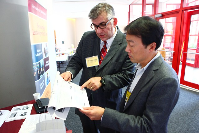 Director of the Us Technological Leadership Institute Massoud Amin talks with Alumni David Hui Liu Friday afternoon in Keeler Hall. Amin was sharing information about the smart electric power grid project at the Department of Electrical and Computer Engineering's open house.