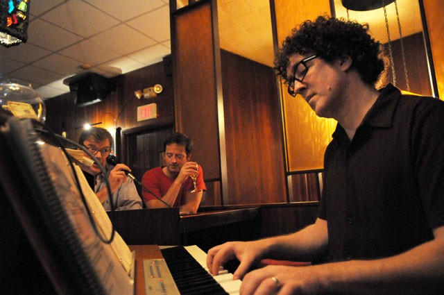 Local musician Andy Cowley plays piano at Nye's Polonaise Bar in northeast Minneapolis Monday while bar-goers sing along.