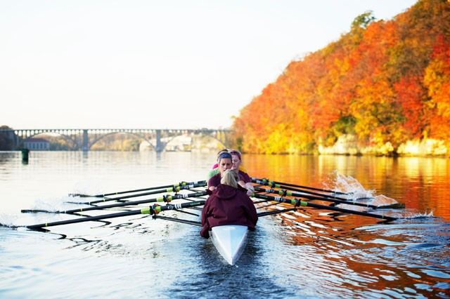 Members of the women's varsity rowing crew prepare to turn upstream Friday morning near the Ford Parkway Bridge.  The varsity level crew practices on the Mississippi at 6:45 am five days a week.