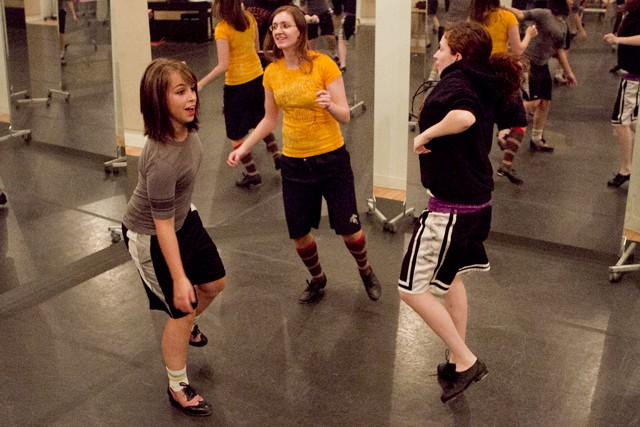 Minneso-tap tap dancing group members Kathleen Burnell (left), Stephanie Hornung (center) and Felicia Hammerschmidt practice Thursday evening at the People's Center on West Bank.