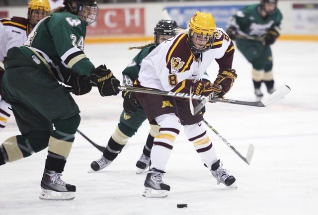 Freshman forward Amanda Kessel advances the puck up the ice at Ridder Arena on Saturday.