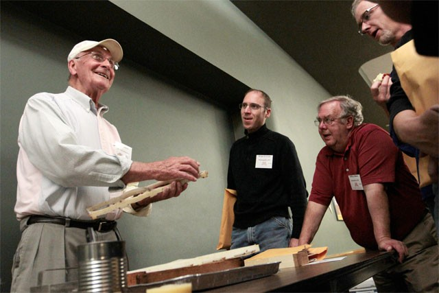 Beekeeping veteran Ted Olson, left, explains techniques for recovering honeycomb from homegrown beehives at the Bell Museum of Natural History on Saturday.
