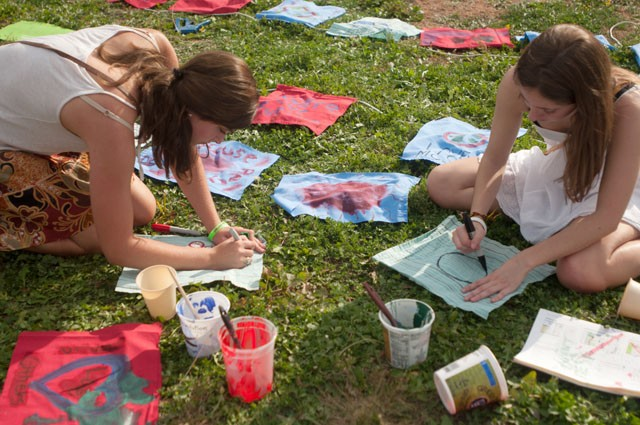 Sara Chars (left) and Chiara Wallace (right) paint flags during the Climate Solutions Revolution on Sunday.