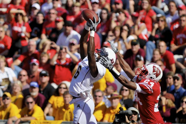 MARK VANCLEAVE, DAILY Badgers redshirt sophomore defensive back Shelton Johnson fails to stop Gophers junior wide receiver Da'Jon McKnight from scoring a touchdown Saturday at Madison.