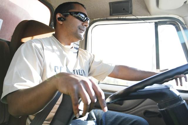 Chandrashaker Bhagwandin drives his tri axel dump truck on highway 52 early Tuesday morning.