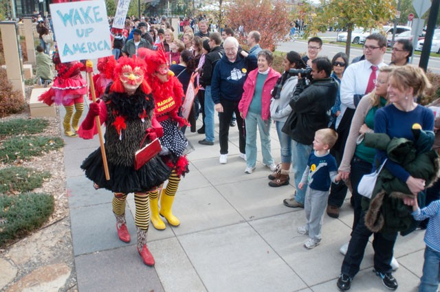 Members of the Radical Roosters anti-war group protest at the Obama rally on Saturday near the entrance of the Field House.