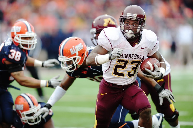 Running back DeLeon Eskridge breaks a tackle to complete a Gophers touchdown Saturday afternoon at Memorial Stadium.  Running for a total of 61 yards, Eskridge provided three of five Minnesota touchdowns.